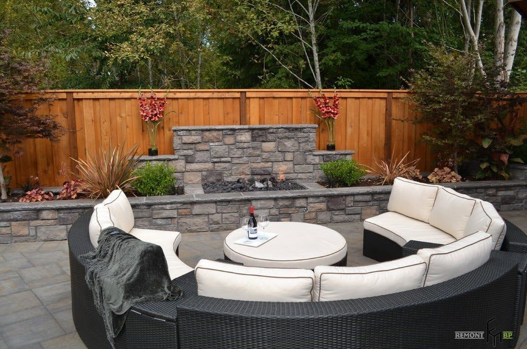 Patio furniture outdoor. Reviewing Types with Photo. Light wooden fence to separate the cozy place for rest