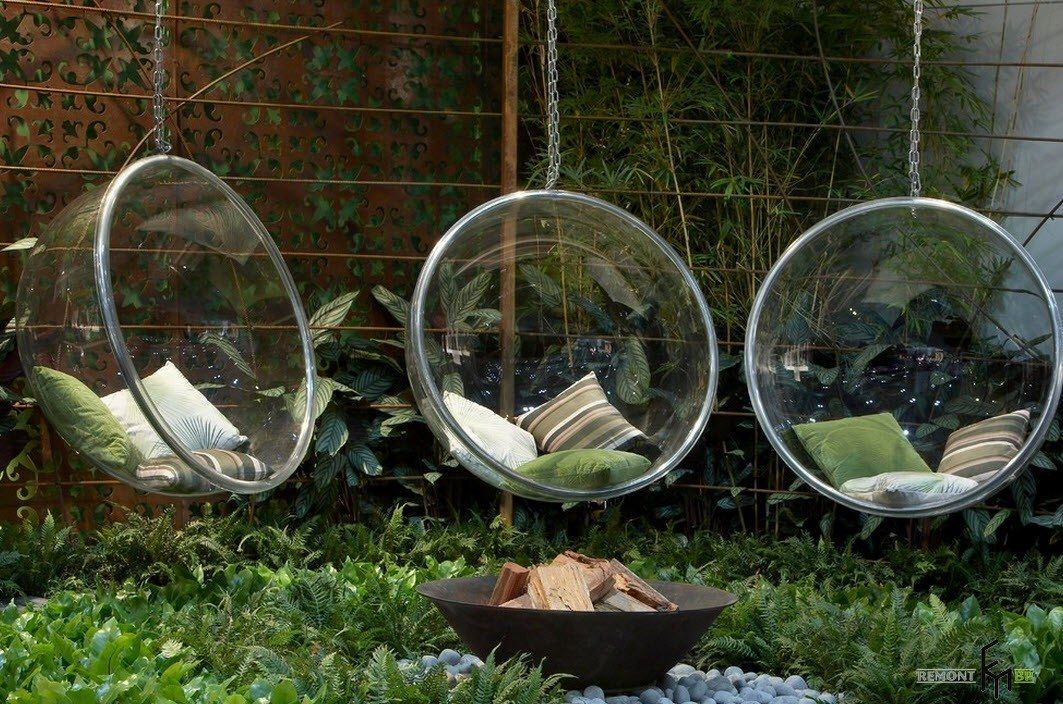 Patio furniture outdoor. Reviewing Types with Photo. Typical plexiglass sphere for rest at the garden