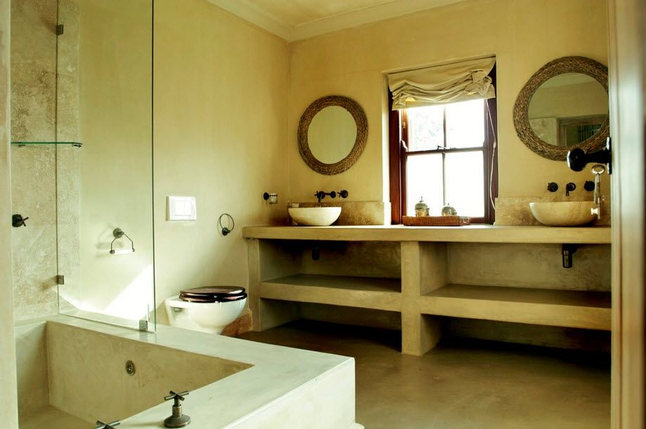 Creamy colored Classic bathroom with shelving and angular bathtub