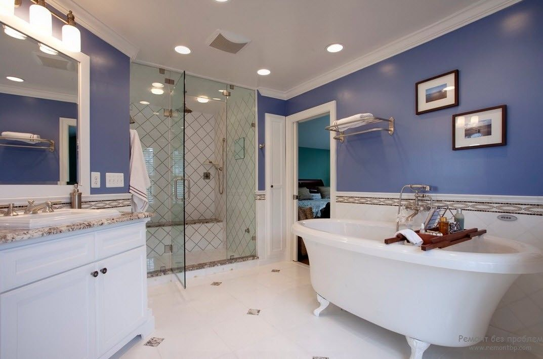 Aquamarine walls for the Classic styled bathroom looks cold but may sooth and refresh after work day