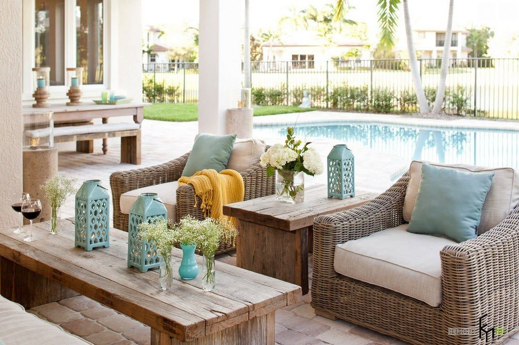 Patio furniture outdoor. Reviewing Types with Photo. Wicker furn and wooden table with slight tuquoise touch