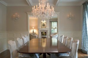 Victorian interior of the dining room with large crystal chandelier and stucco decorated ceiling with open beams
