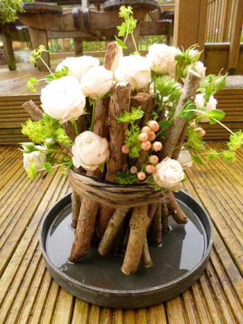 Totally unusual naturalistic design of the flower stand of tree branches