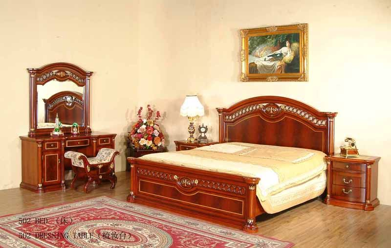 Typical Classic in the room with the red wooden bed and same material made boudoir