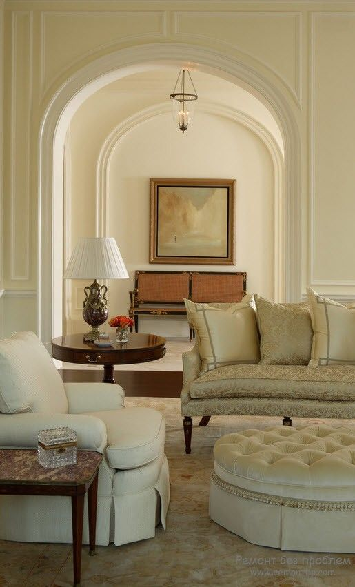 Arches in the open layout living room decorated with stucco
