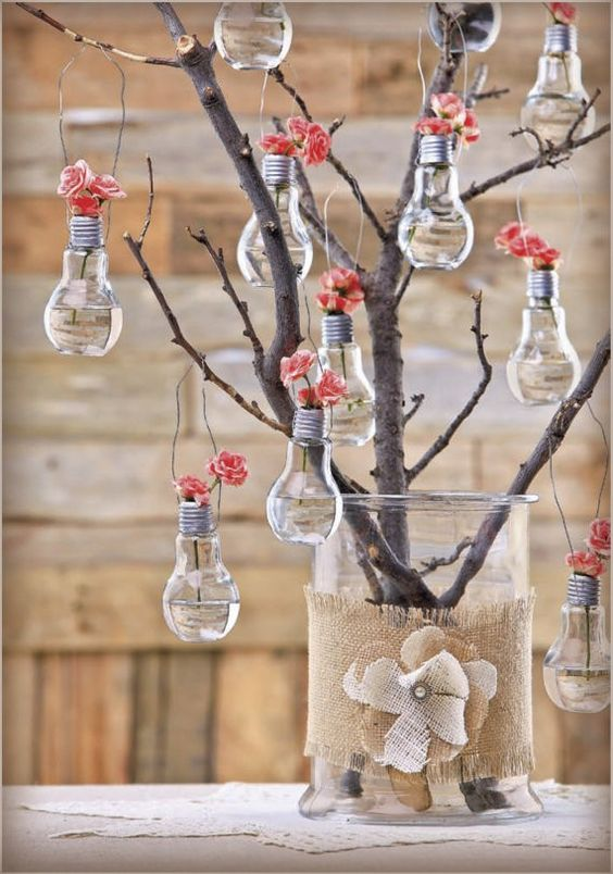Mere bulbs suspnded at the tree with flowers