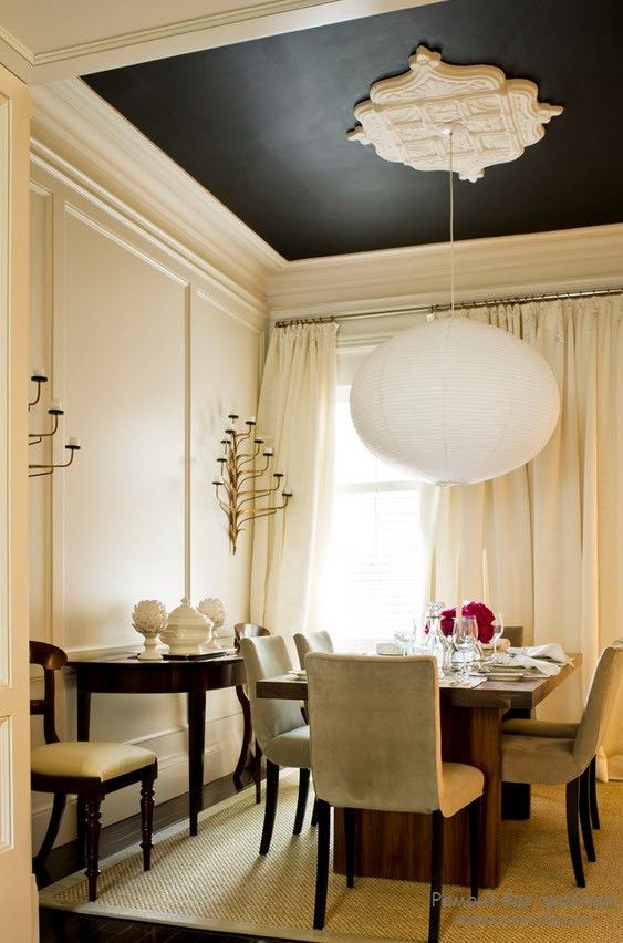 Pastel creamy color scheme for the classically decorated living room with stucco friezes on walls and dark ceiling