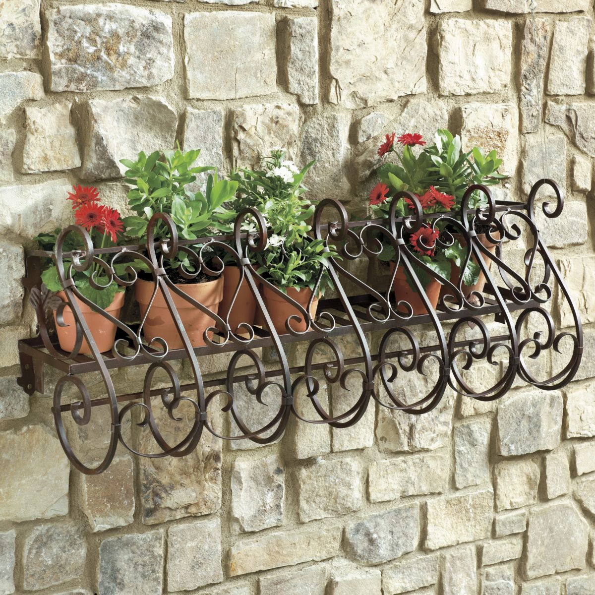 Nice looking metal forged wall flower stand resembling the top of medieval gate