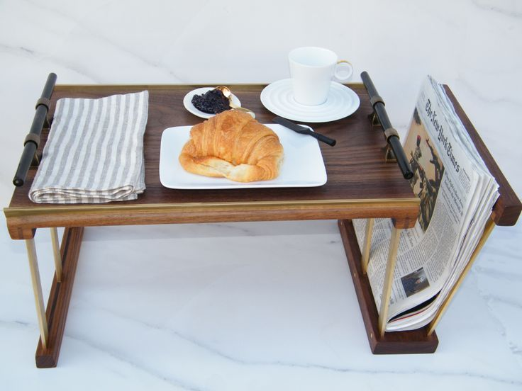 Breakfast as a whole composition on the dark brown bed tray