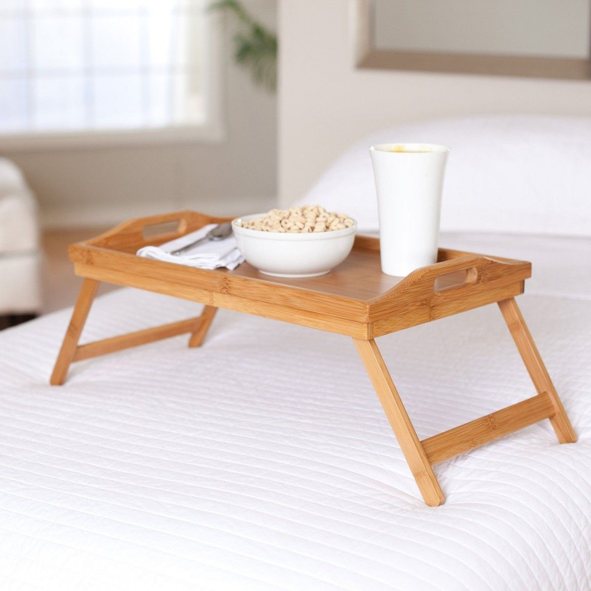 Overbed Table (Bed Tray). Expanding Functionality Element in Modern Home. Foldout light wooden tray for breakfast