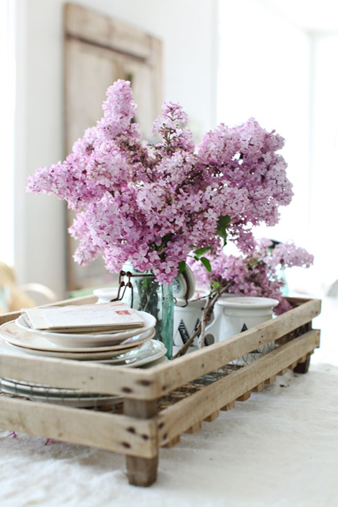 Lilac twig with blossom on the classic wooden bed tray