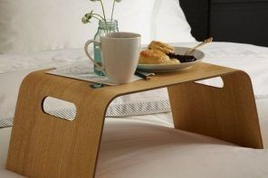 Modern minimalsitic form of the bed tray of wood