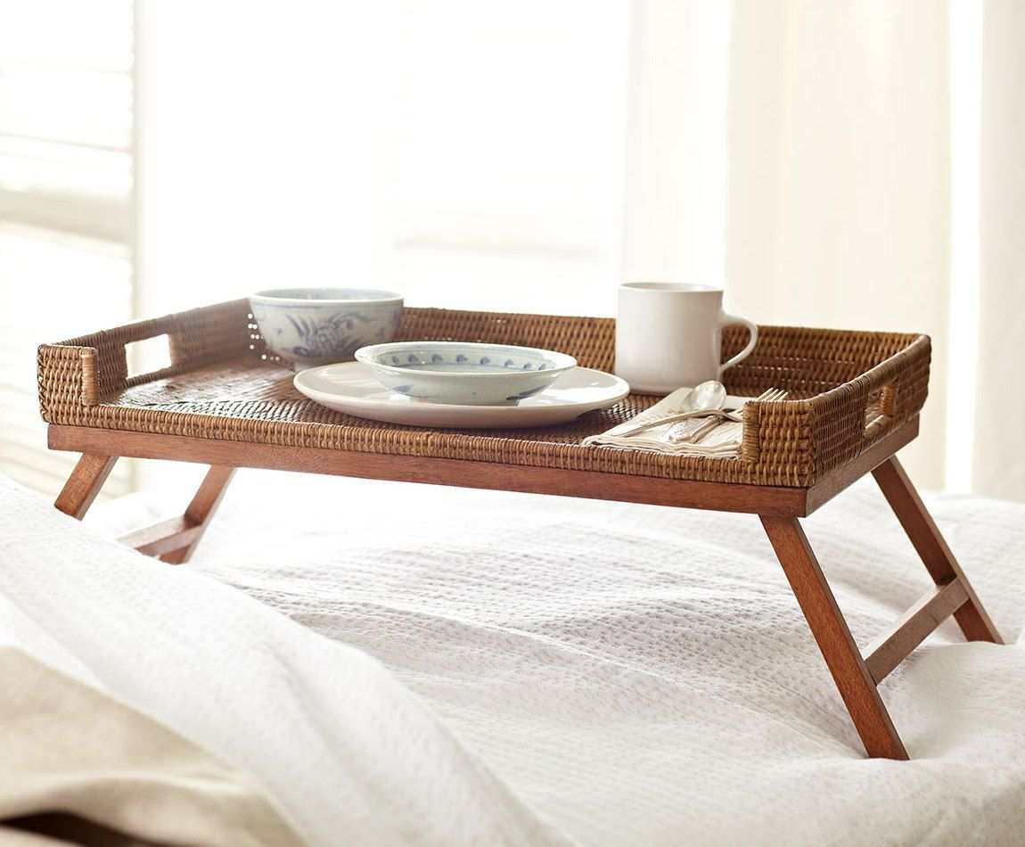Folding legs for overbed tray with coffe cup and the dishes