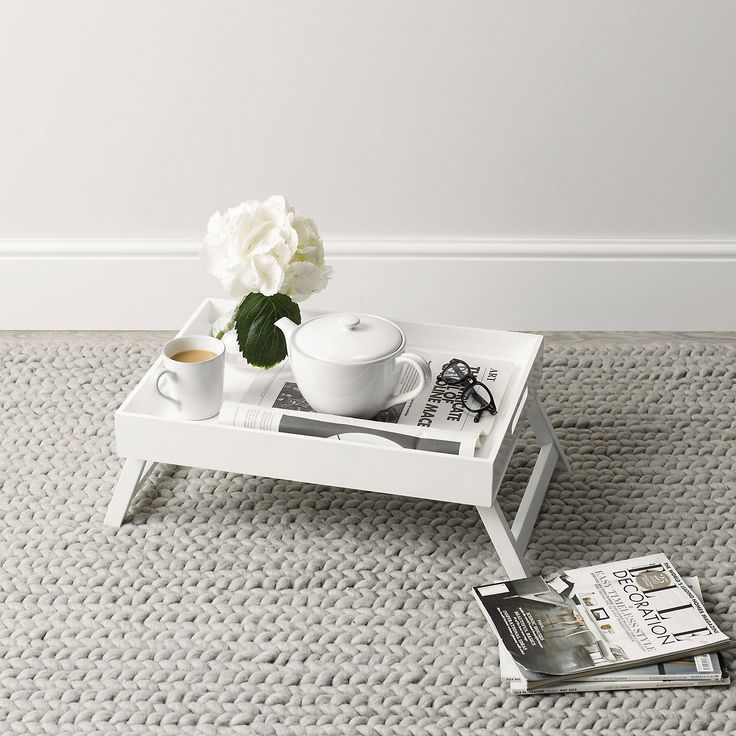 Classic white overbed table at the floor