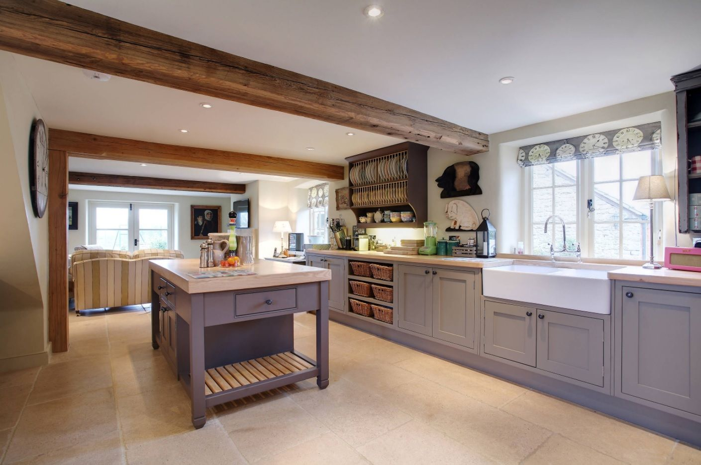 Large open layout space of the bespoke kitchen with minimalism and rustic styles combination