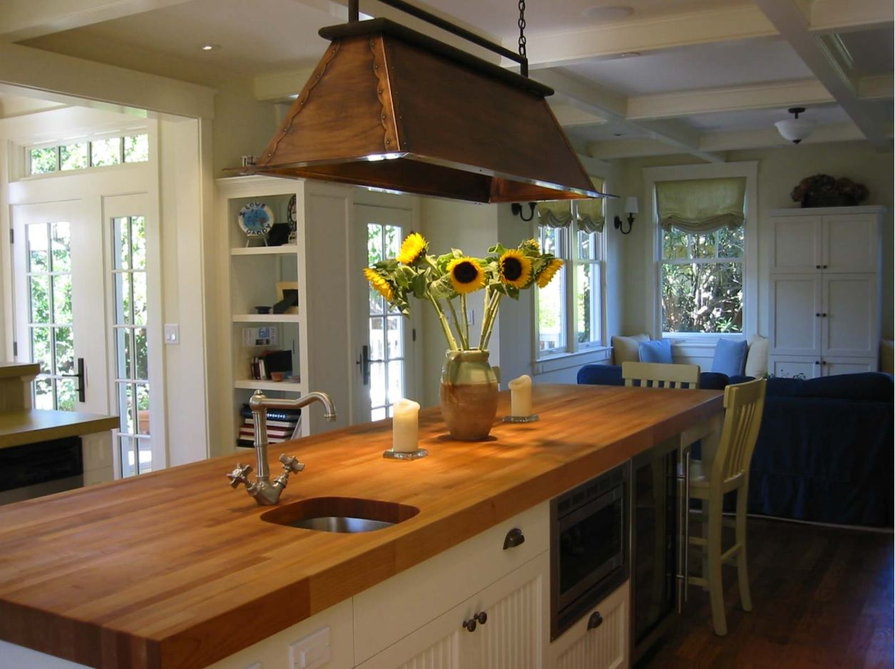 Butcher Block Countertop in Modern Kitchen Interior. Topical Rustic style for suburban cottage with sunflowers as a decoration