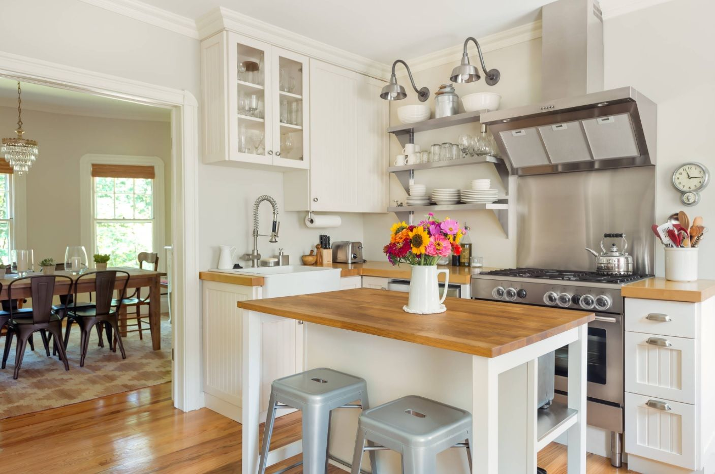 Butcher Block Countertop in Modern Kitchen Interior. Large open layout space with the island and wooden tops
