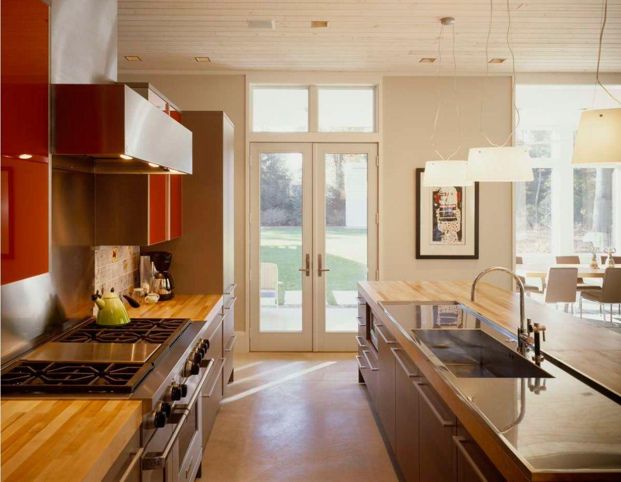 Butcher Block Countertop in Modern Kitchen Interior. Panoramic door giving light