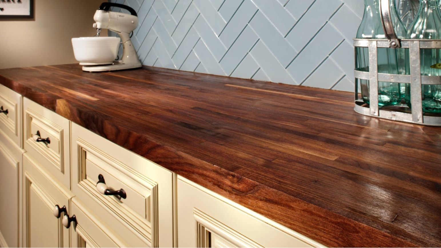 Butcher Block Countertop in Modern Kitchen Interior. Close-up view to the red wooden top