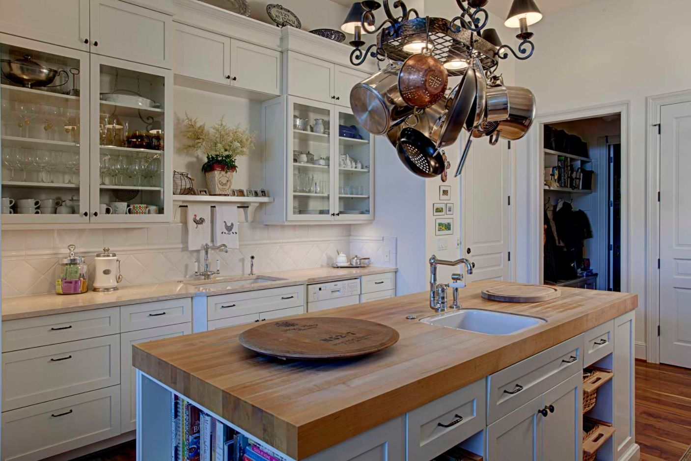 Butcher Block Countertop in Modern Kitchen Interior. White matted furniture facades for the modern Rustic setting