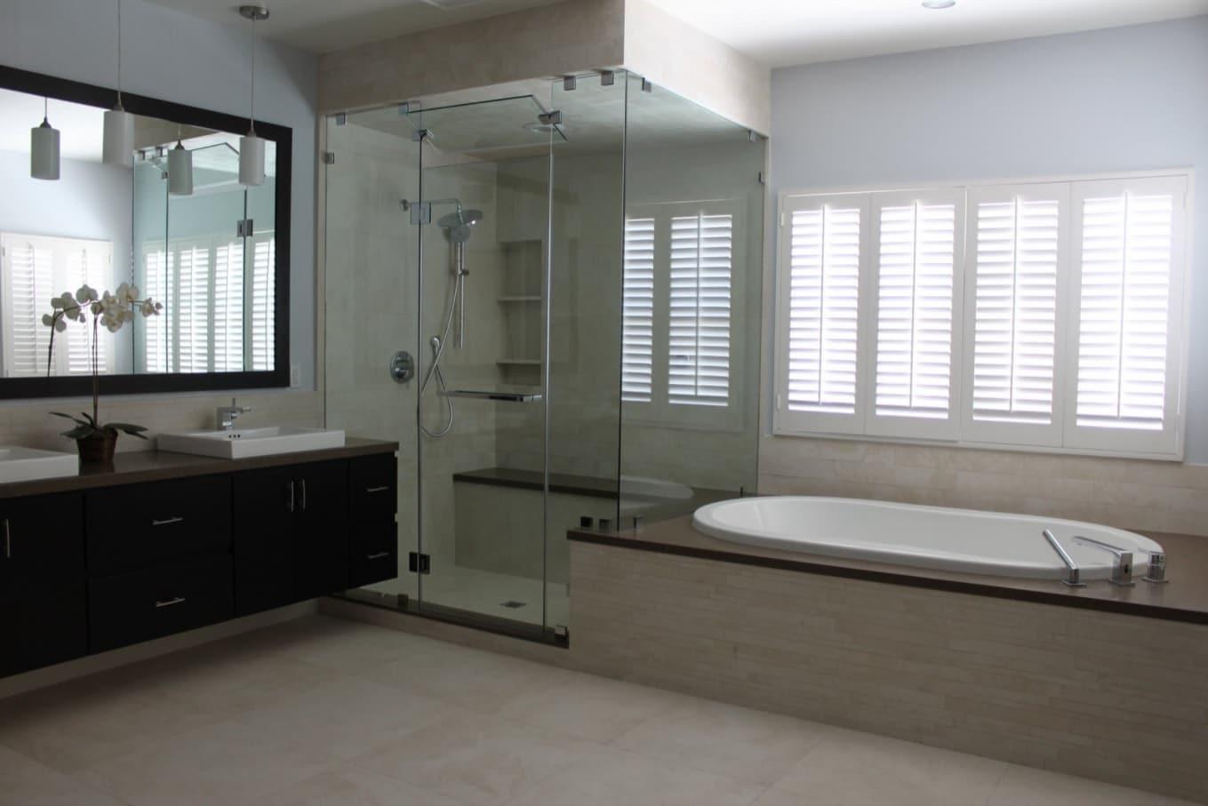 Light pastel color palette in modern designed bathroom with glass shower cabin