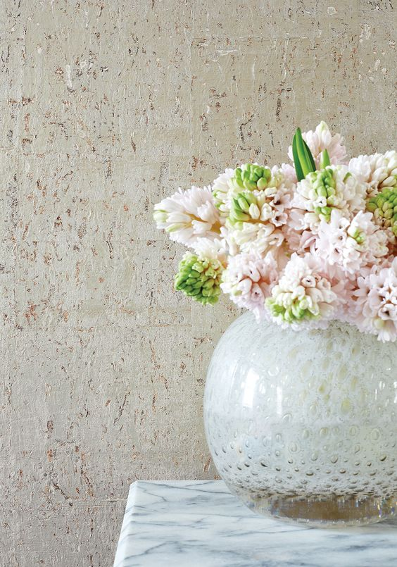 bulb vase with flower bouquet and the light gray stained cork wallpaper