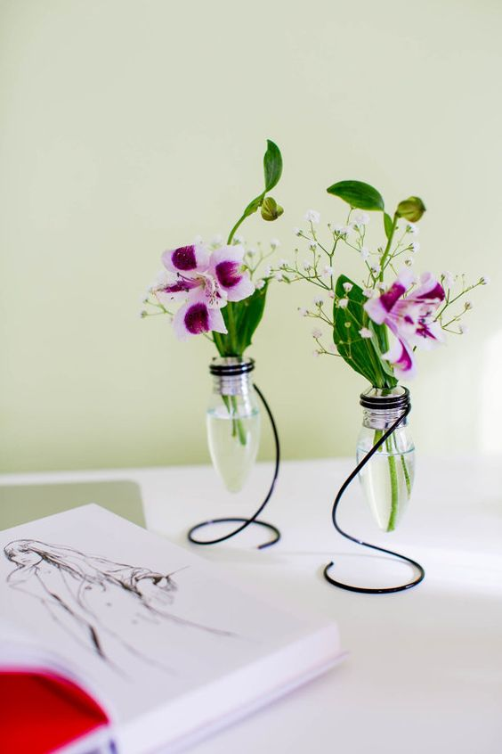 Peculiar metal rod as the basement for the glass jar as flower vase