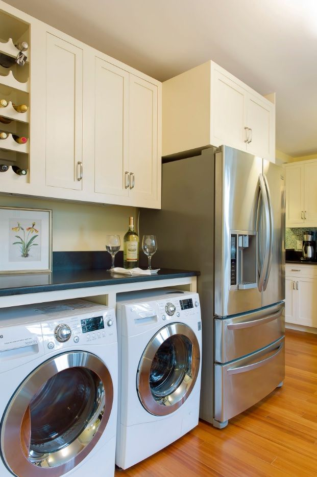 Laundry & Kitchen Functional Space Combination. Modern appliances gives hi-tech appearance to the room