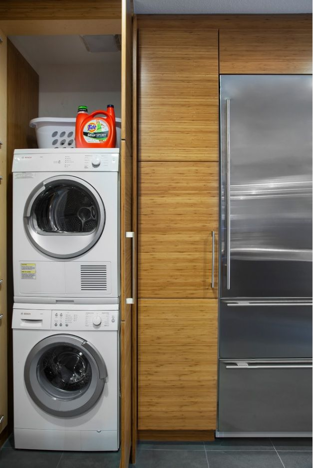 Laundry & Kitchen Functional Space Combination. One in one washing and drying machines in the storage