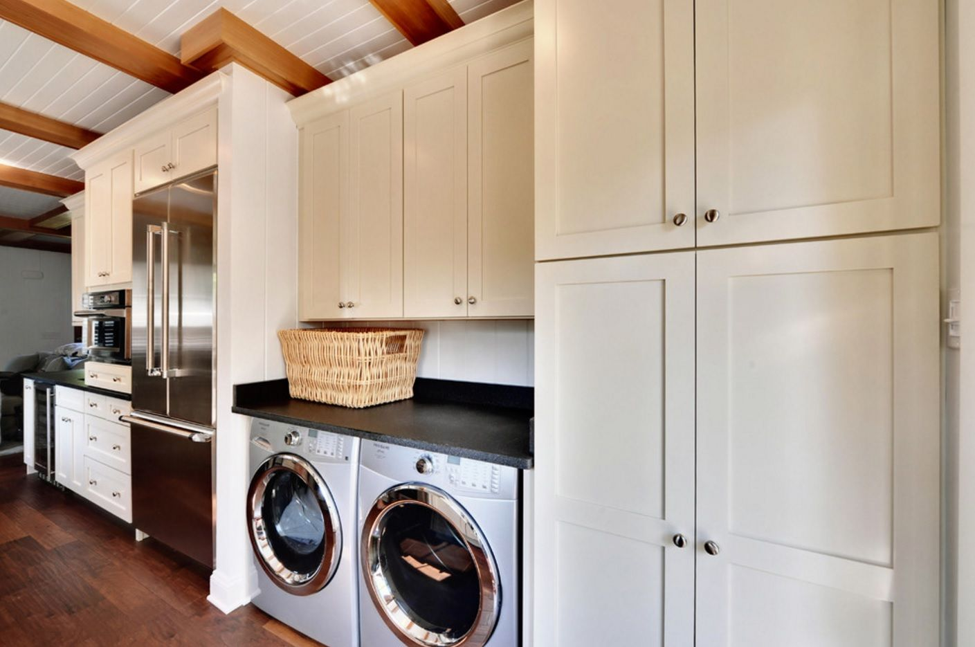 Open layout of the kitchen with coupled washing and drying machines