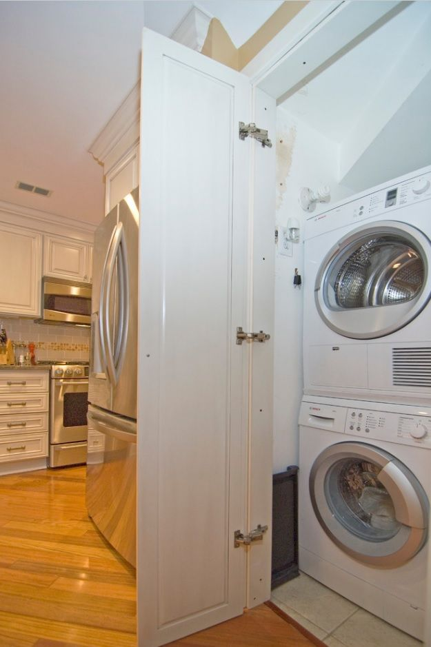 Matted white facades of the kitchen hiding the home appliances
