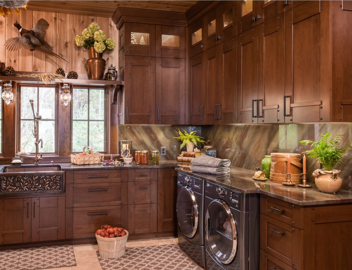 Dark kitchen interior successfuly took the combination of natural materials and modern home appliances