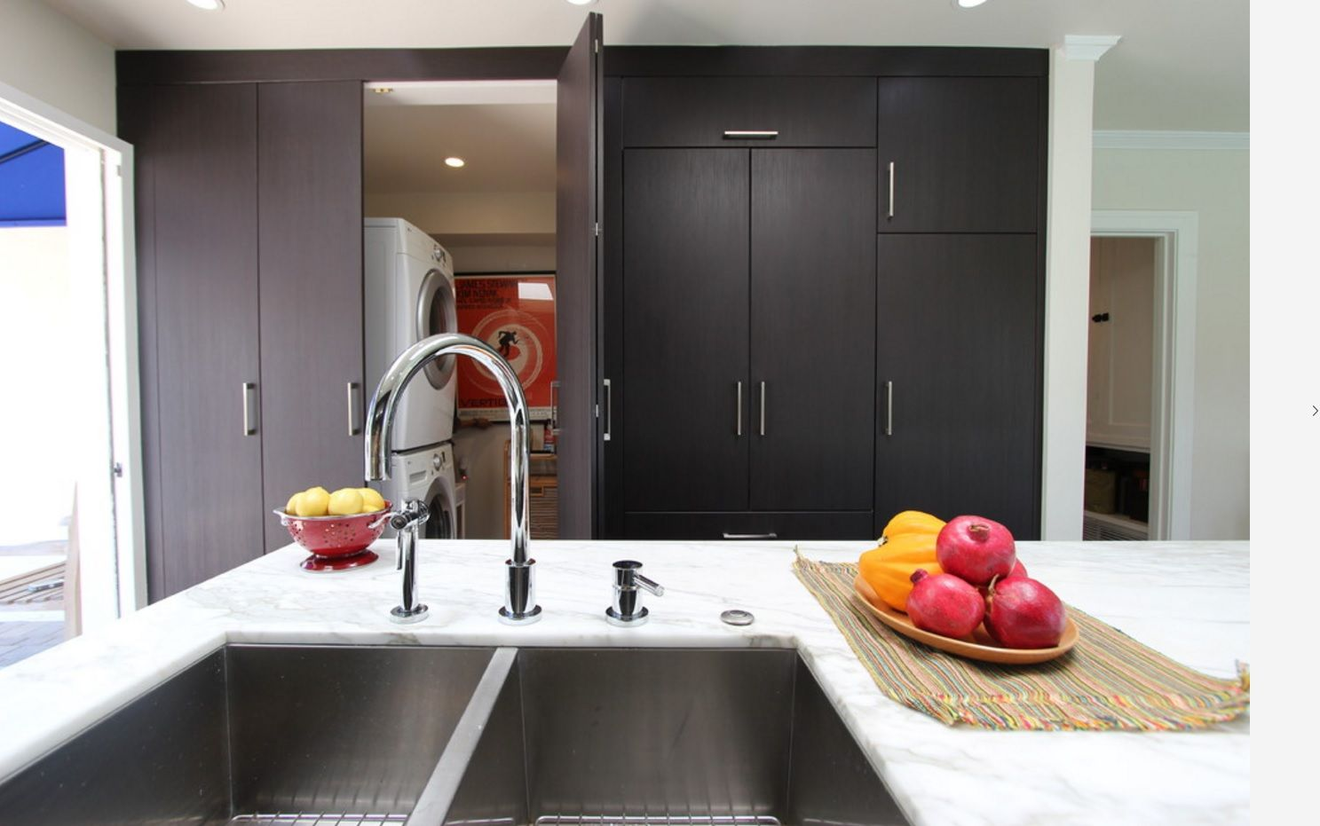 Contrasting dark and white interior with all necessary at the kitchen