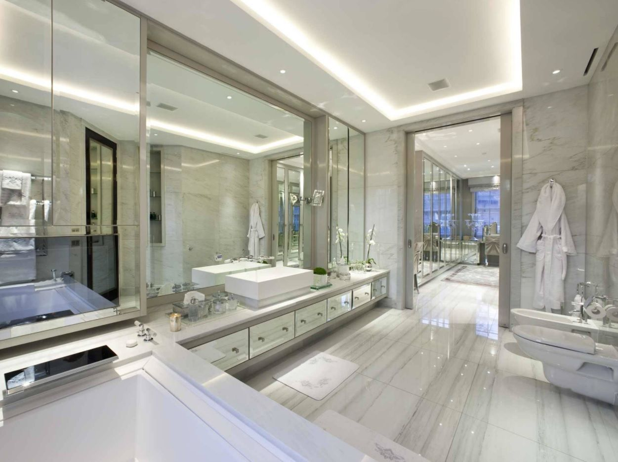 Spectacular scale of the master bathroom with multilevel backlight, luxurious finishing materials and huge mirror