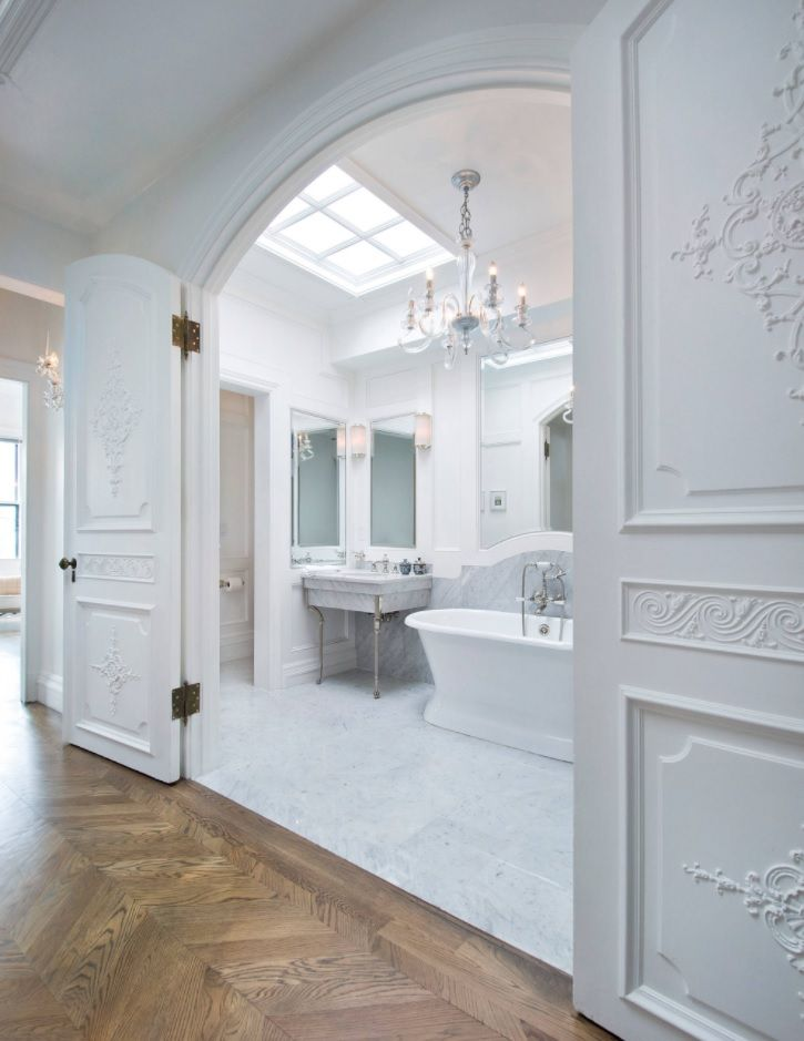 White classics in the bathroom with wide open entrance from the hallway