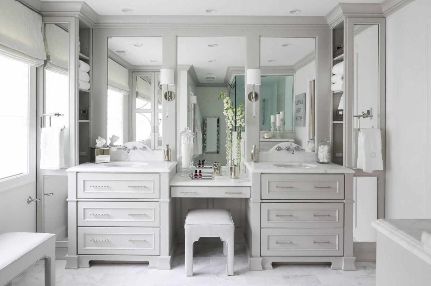 Classic gray boudoir with the cabinets, shelvings and large mirrors in master bathroom