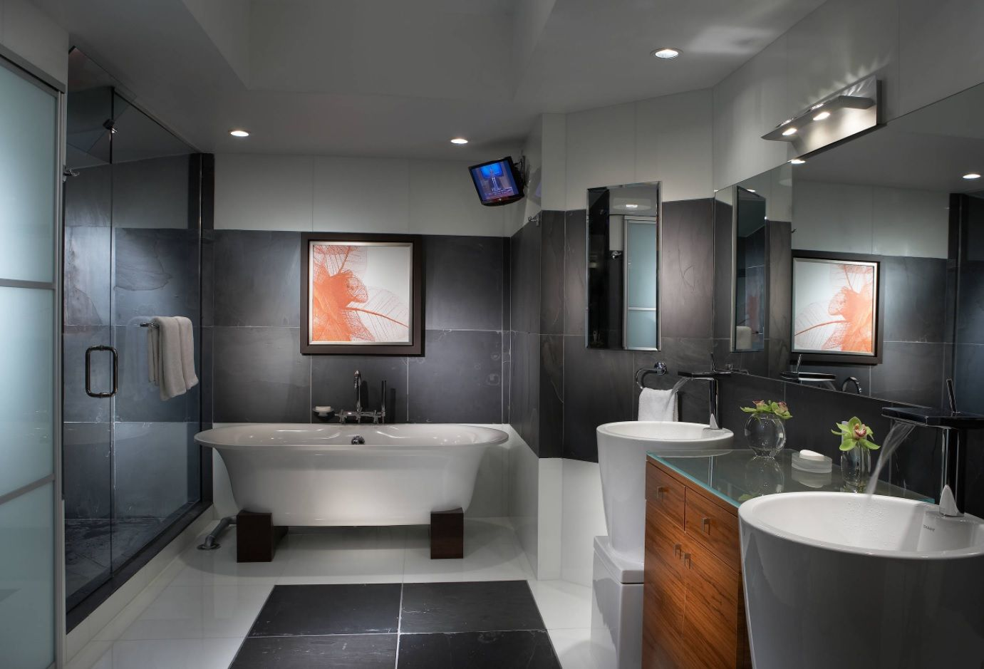 Dark interior finishing for modern master bathroom with picture