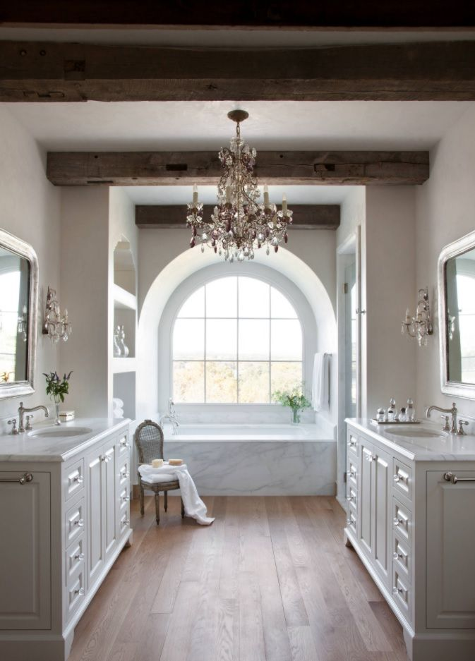 Classic white interior with arched lattice window