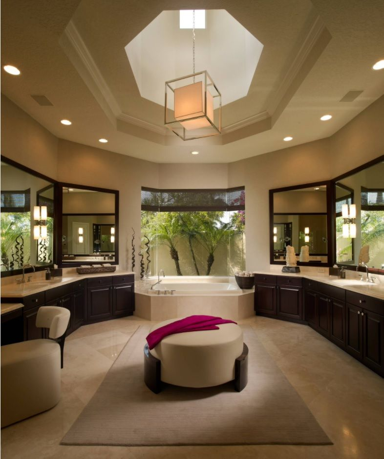 Master Bathroom Design Ideas with Real Interior Photos. Round room with boudoir for two with round ottoman and with complex artificial lighting