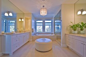Master Bathroom Design Ideas with Real Interior Photos. Classic white creamy interior with round ottoman in the center