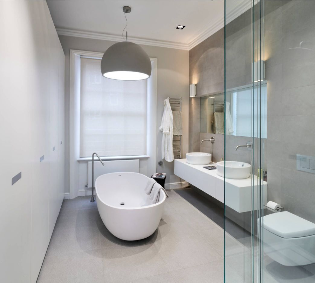 Master Bathroom Design Ideas with Real Interior Photos. Dark and light shades of gray in the modern bathroom with vintage forms of bathtub and sinks looks elegant
