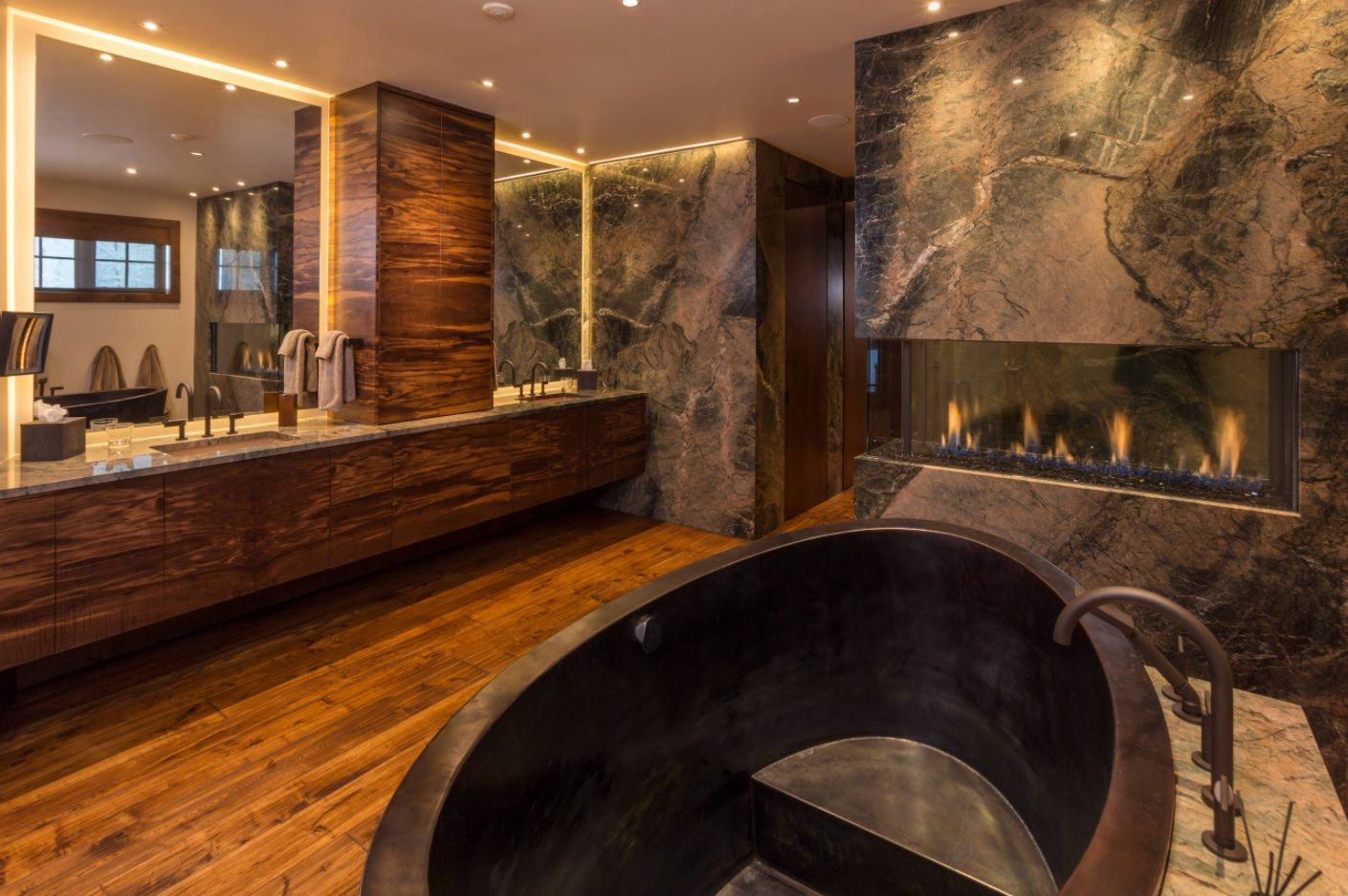 Master Bathroom Design Ideas with Real Interior Photos. Nice dark interior of the ultramodern room trimmed with natural materials