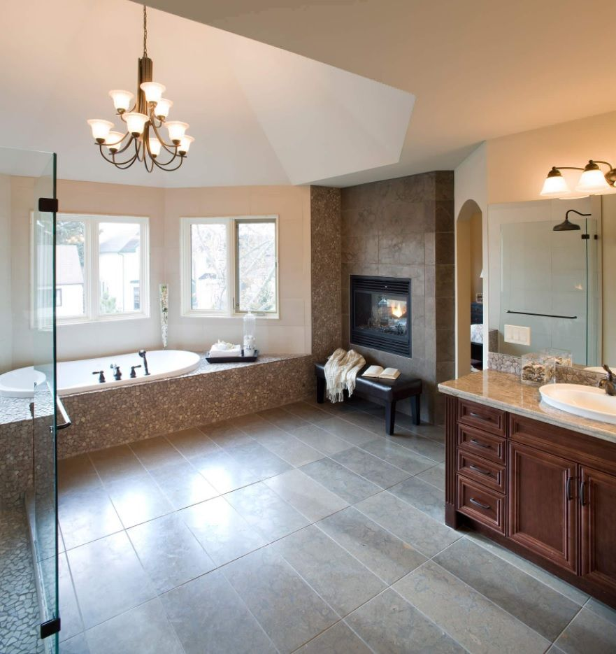 Master Bathroom Design Ideas with Real Interior Photos. Spacious classic styled interior with wooden vanity and royal size trimmed bathtub