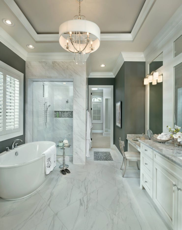Master Bathroom Design Ideas with Real Interior Photos. White marble trimmed room in Classic style with gray painted walls