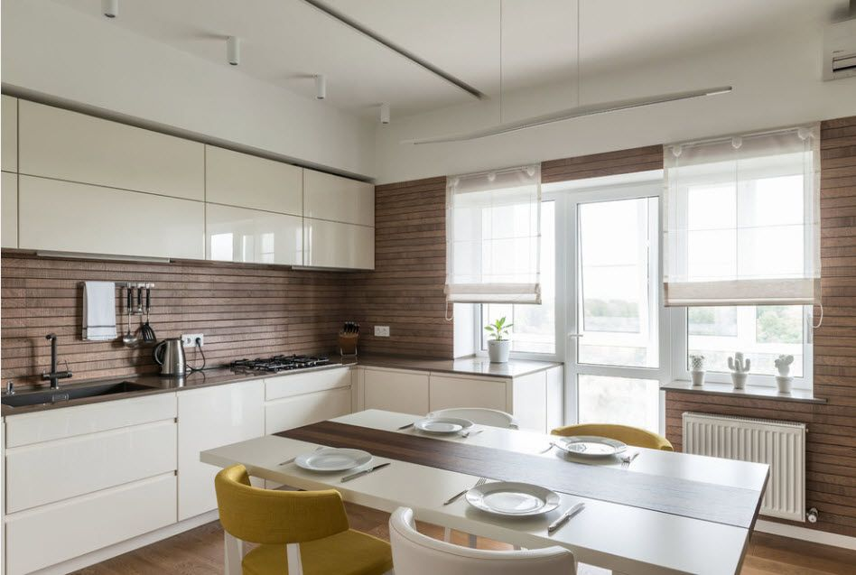 Kitchen Combined with Loggia or Balcony Design Ideas. Wooden backsplash and white plastic kitchen facades