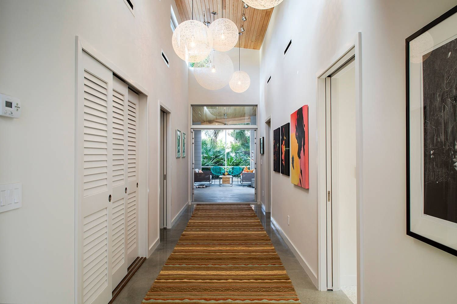 White matted walls and planked surfaces of the hall closet
