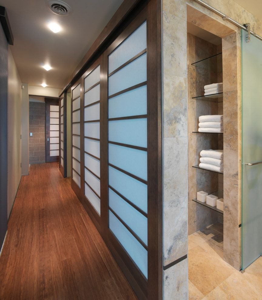Long narrow hallway with the built-in storage of the closet with backlight