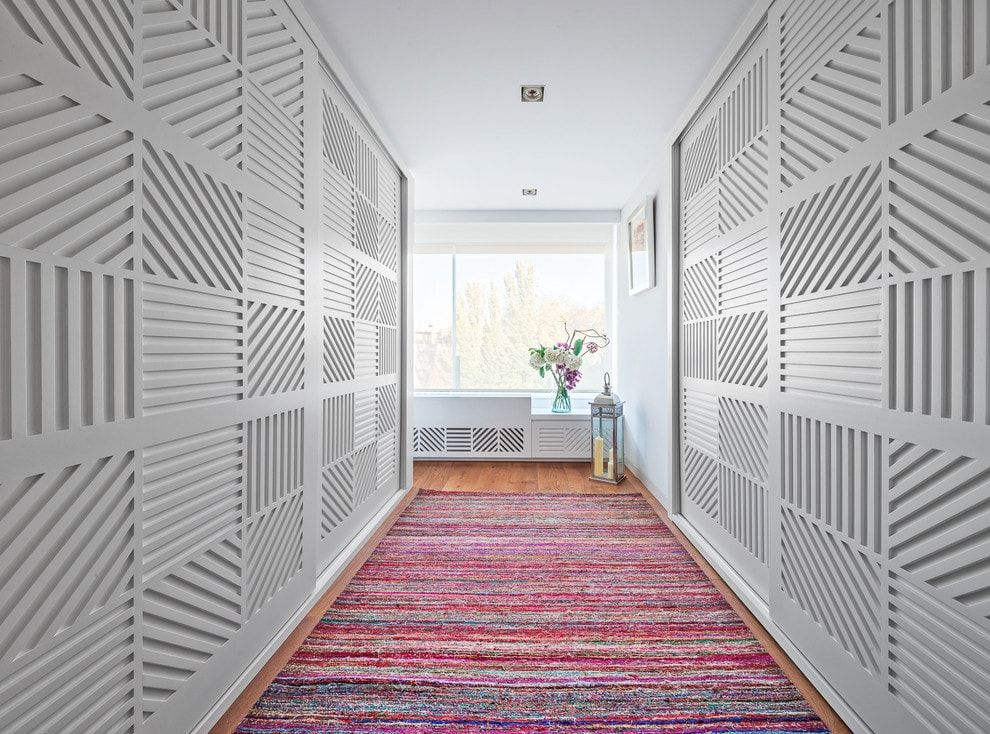 Modern Closet Types & Variants for Hallway Interior with Photos. White panels with structure takes both sides of the hall
