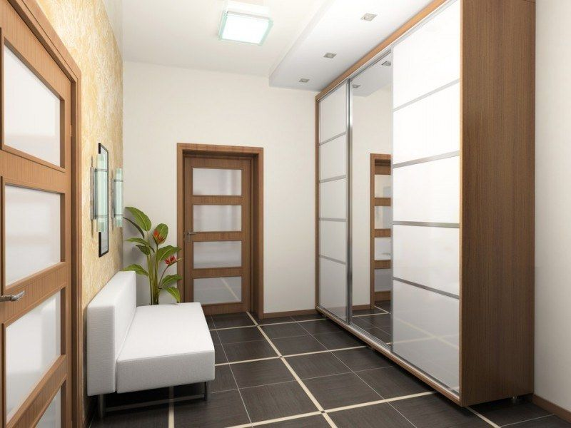 Design complementing closet in the Eco styled hallway with glancing black tile at the floor