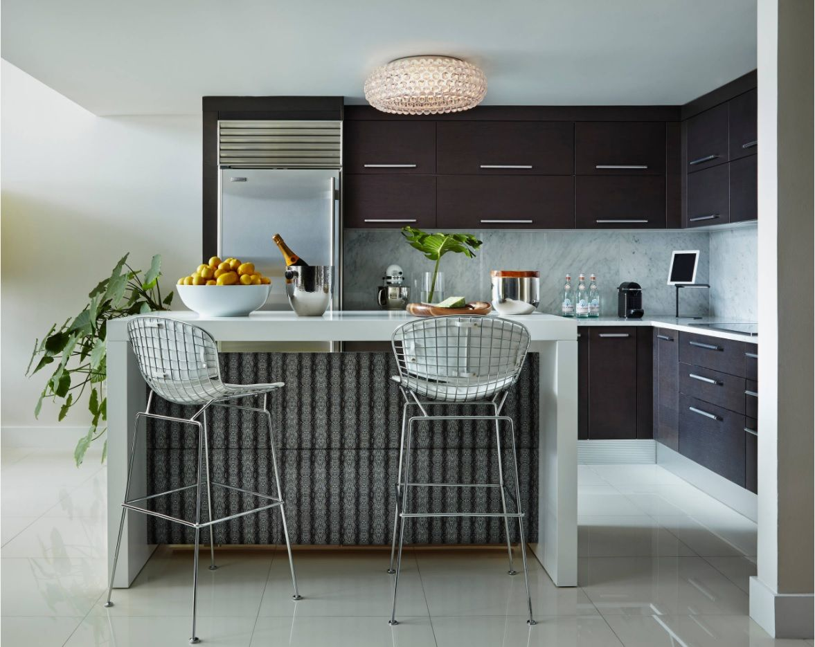 Dark kitchen facades and the metal framed stools